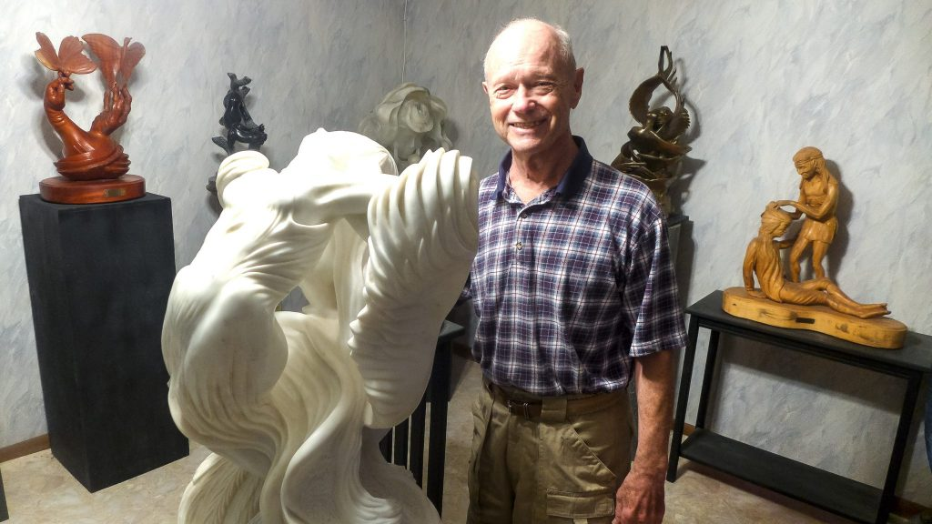 Artist Nelson Nichols in his home studio gallery